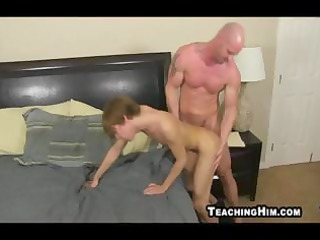muscular mature guy bends over and dominates a