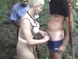 horny wife has pleasure wuth voyeurs in forest.