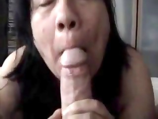 plump cougar swallows his penis and sucks his