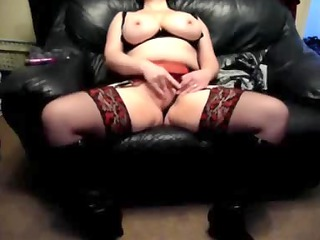 busty lady on a leather sofa at house