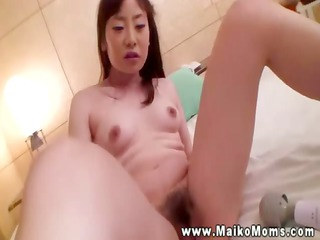 grownup asian bitch acquires her furry pussy