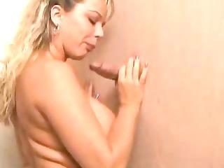 busty blonde sucks a libido through the gloryhole